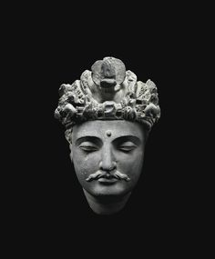 Tête de Bodhisattva en schiste gris Gandhâra, II<sup>E</sup>-III<sup>E</sup> siècle | lot | Sotheby's