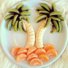 Pin for Later: 61 Food Art Ideas For Kids That Are Almost Too Cute to Eat Sweet Paradise Palm trees made from fruit remind us of the carefree days of Summer.