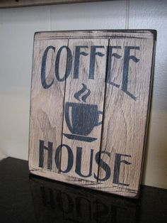 Coffee Wood Sign Display your love of coffee with this charming Coffee Wood sign. This adorable 3-panel wood sign features 'Coffee House' in black with a streaming mug in between the words. This wood