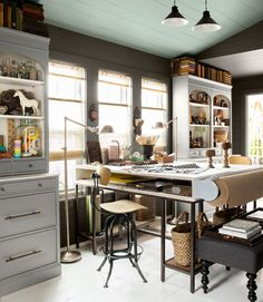 Love this workplace + great Idea with the paper roll attached to the edge of the desk- perfect for trace or vellum.
