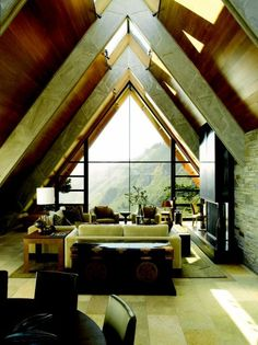 i'm relaxed just looking at this. atic bedroom, with great architecture, and a great view.