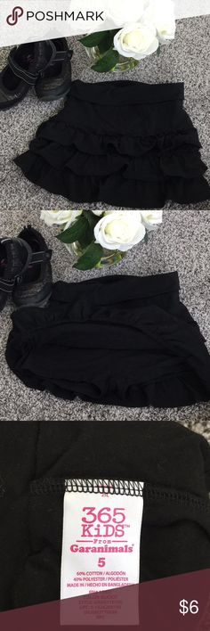 EUC Garanimals black ruffle skort Size 5 Fold over waistband for adjusting! Ruffle skirt and shorts so they are still able to play while wearing their cute skirts. Size 5 I have a pink one in my closet also....bundle for a great deal Garanimals Bottoms Skorts