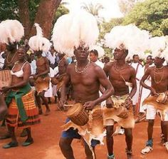 These people are dancing to some Ugandan music. There costumes makes Uganda unique to other countries around the world.