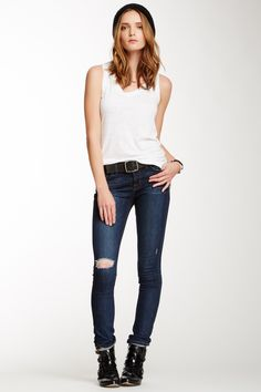 "Mid-Rise Rail Jean in Norfolk by J Brand $169 - $79 @HauteLook. Sizing: 28=6, 29=8, 30=10, 31=10-12, 32=12. - Zip fly with button closure - Mid-rise waist - Skinny leg - Approx. 8"" rise, 32"" inseam - Made in USA Fit: this style fits true to size. Model's stats: - Height: 5'11"" - Waist: 25"" - Hips: 35"" Model is wearing size 26. Machine wash. 92% cotton, 7% polyester, 1% spandex."