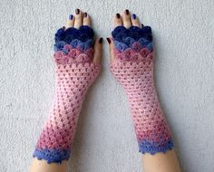 A beautiful hand crochet pair of fingerless gloves. Romantic and feminine unique pattern, perfect length and thickness. Keeps your fingers free but