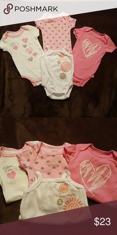Baby Calvin Klein bundle onesies Four Calvin Klein onesies. All in great condition.  All are 0-3 months. Calvin Klein One Pieces