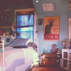 Eclectic bedroom--Love the poster.
