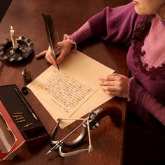 lady writing a letter w/feather quill pen
