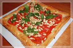 Keswick Island Guest House: Tomato & Feta Tart: Crispy puff pastry brushed with garlic infused olive oil, topped with feta cheese, finely shredded basil leaves & layered tomatoes. Garnished with with basil, salt & peper, & toasted pinenuts.