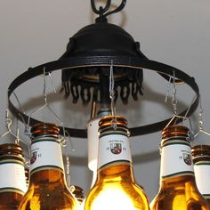 We love upcycled lighting! Learn how to make this awesome beer bottle lamp from old, broken lamps and beer bottles! This upcycle is easier than it looks.
