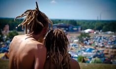 18th Woodstock Festival Poland - a couple admiring the view of the Woodstock camp site.