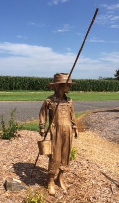 'Anita Viola' is a repurposed mannequin.  I finished her in time to grace my summer garden. Anita is named for my friend & Viola my mothers middle name. My little fisher girl holds a cane pole & a can of worms. She sports my mothers vintage garden hat. Rebecca Jones Smith