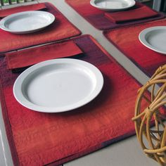 "The Marimekko print ""Selanne"" has all the gorgeous shades of autumn leaves – old mauve, purple taupe, rosewood, sienna, burnt orange and dark red. This placemat/napkin set of four will add warm color and comfort to your table setting. The placemats are reversible – one side features the taupe and brown colors of Selanne and the other side features the claret and burnt orange colors."