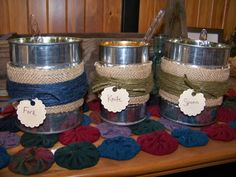 Utensil holders.  Upcycled cans covered in burlap and wrapped in jute.
