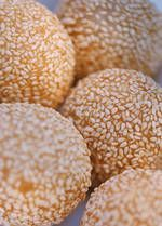 Sesame Seed Balls ~ Note: This is one of the more difficult Chinese recipes. The problem comes during deep-frying - the sesame seed balls need to be turned continually to expand. It takes practice to skillfully maneuver the balls in the hot oil. Even with practice, you may not have the perfectly shaped, large sesame seed balls sold at Chinese bakeries.