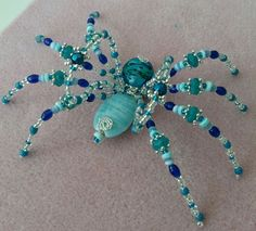 """A returning customer special request: """"shades of blue, turquoise, green and wings"""" beaded spider by PurpleDreamDesign"""