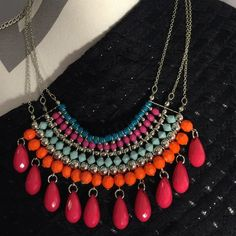 Beautiful statement necklace by Mudd Beautiful statement necklace in silver colored chains. The beads are colored mauve, orange, gray, maroon and blue. 18 inches long made by the brand Mudd. Mudd Jewelry Necklaces