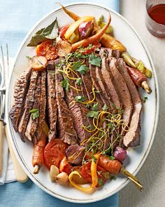 """Nothing says """"special occasion"""" like our melt-in-your-mouth beef brisket recipe. Each bite of the easy Christmas main dish boasts bold ginger and citrus flavors. #traditionalchristmasdinner #holidaydinnermenu #classicchristmasdinnerideas #familydinner #bhg"""