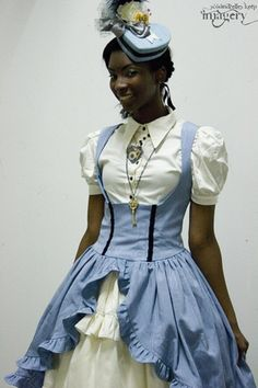 I absolutely love this! You don't see many black Lolita, I always love to see pictures. :) I want that hat, holy buckets.
