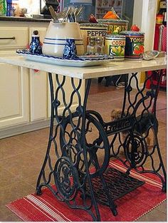 Singer table. An idea for mine, although mine still has original top and sewing machine inside, need to find a way to incorporate...