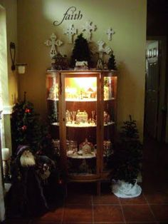 Christmas village in a lit china cabinet