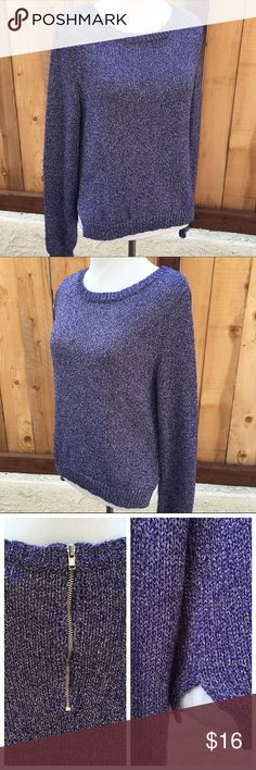 "Purple Sweater Purple & metallic Silver threads. This pull over sweater has a zipper in back & two side slits at bottom of sweater. First & second photos are true to color. Pit to pit is 19.5"" & length is 19.25"" from shoulder seam to bottom of sweater. Content is 60% Acrylic, 27% Polyester & 13% silver Metallic Fiber. NO holes, pilling or spots. In great preloved condition. Divided Sweaters Crew & Scoop Necks"