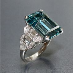 Art Deco Vintage 12.16 carat emerald cut aquamarine ring with baguette, bullet shaped and round diamonds set in platinum by Raymond Yard. #ArtDecoAquamarine