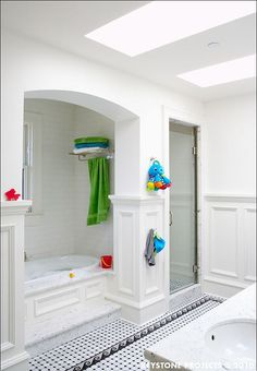 Tub alcove, separate shower, skylights