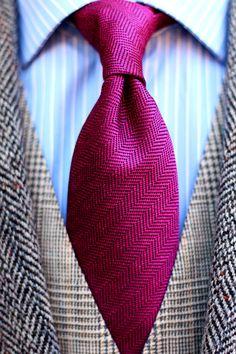 Herringbone designer tie in magenta pink paired with tweed jacket and vest