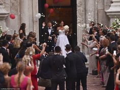 Applause: A large crowd of well-wishers and loved ones cheered and applauded the couple as they made their exit as husband and wife