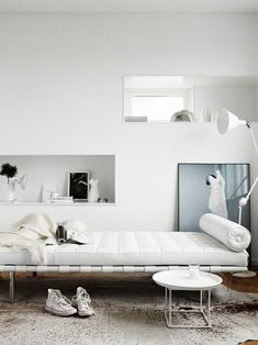 Perfect white room, with stunning Barcelona Couch by Ludwig Mies van der Rohe for Knoll, available at DREAM Interiors.