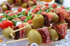 Stuffed olive, salami and sun-dried tomato skewers and Caprese skewers