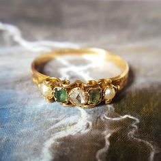 Pearls for purity, emeralds for wisdom in love, and a diamond for true and everlasting love. According to sources of the time, these would be the