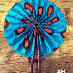 These colorful hand fans are our bestseller. Made out of leather and African print fabric they are a hot accessory for the Summer. Must have accessory! African Girl, African Dress, African Fashion, Hand Held Fan, Hand Fans, African Prints, African Fabric, Ankara Designs, Big Girl Fashion