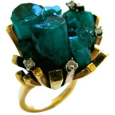 An Emerald and Gold Cocktail Ring c 1970 USA An Artistic Emerald and diamond ring. The hand-crafted 1 rough-cut Chatham emerald, enhanced with five round white diamonds mounted in freeform gold. Casual enough for jeans and elegant I Love Jewelry, Jewelry Art, Antique Jewelry, Gemstone Jewelry, Jewelry Rings, Vintage Jewelry, Jewelry Accessories, Fine Jewelry, Jewelry Design