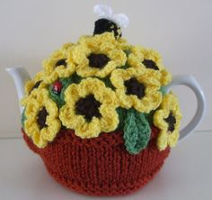 Hand Knitted Tea Cosy with Crocheted Yellow Flowers