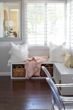 Create a cozy nook to relax with pillows and throws that will make you want to stay a while.  Use baskets to store your favorite books, for stylish convenience too.  HomeGoods Sponsored Pin.