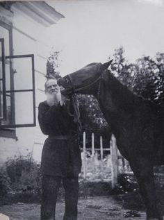 Leo Tolstoy with his horse.