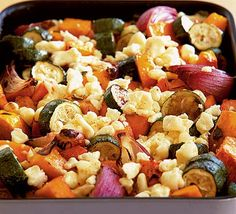 A colourful and hearty vegetarian supper dish for autumn - made in one roasting tin, from Roz Denny