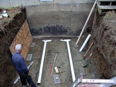 Drainage Pipes for Root Cellar. The hole has been dug! It was tricky because my back steps are a few feet to the right of the hole and a retaining wall is just to the left of the hole. It took a lot of careful digging to avoid the collapse of that retaining wall. Some soil did fall out from under the steps, but a new concrete footing was poured under the post for the step and things were set straight.