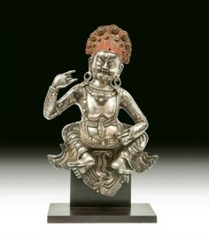 A very unusual Sino-Tibetan cast silver and repousse' figure of Jambhala, The Wealth Deity, 18th century. Photo Dreweatts & Bloomsbury Auctions