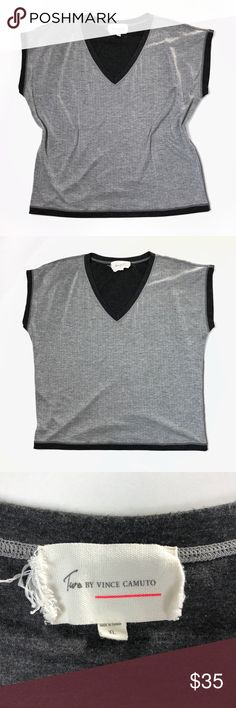 Two by Vince Camuto metallic gray v-neck t-shirt Two by Vince Camuto gray sleeveless tee with black cuff detail. Metallic threading throughout for a subtle shimmer. Super soft! In excellent preowned condition.  • polyester/rayon/nylon/metallic • boxy fit • size xl  Measurements: • chest: 47 • length: 25.5 Two by Vince Camuto Tops Tees - Short Sleeve