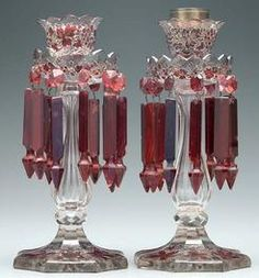 lighting, America, A pair clear glass lustres, hung with ruby prisms, brass mounts at top. Crica 1876-1925