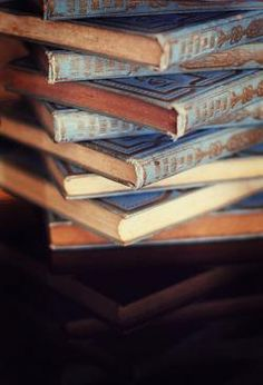 "Blue-and-brown books. ""Fortunately, there is more to life than death. There is for one thing, fiction. A thousand thousand characters to be sent marching out into the world to divert time from its forward gallop to the terrible horizon."" ― Fay Weldon, Down Among the Women"