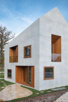 Festung des Wir: Doppelhaus der Schweizer Clavienrossier Architectes. Das Rhomboid wirkt mal wie Urhütte und mal wie Villa