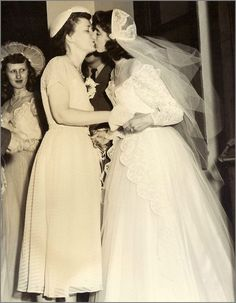 Lesbian couple's wedding 1950's Look at the two different length dresses! i think it'll work fine.