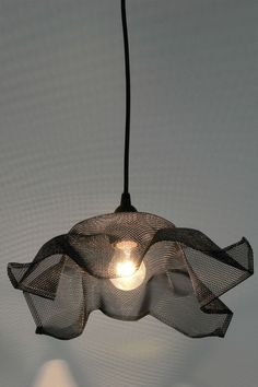 mesh pendant light fixture with copper highlights
