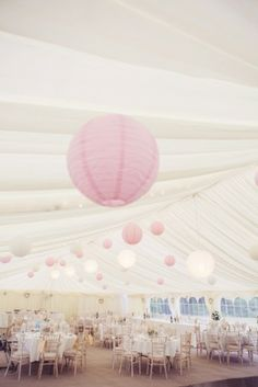 Photographed by juliaandyou.com. Soft and romantic, perfect for a pink marquee wedding.