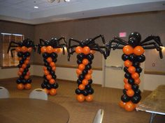 Halloween themed balloon columns with spider toppers are great for a kids party! | Balloons by Tommy | #balloonsbytommy