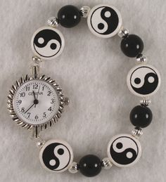 Cerm01 watch with a band made of ying yang ceramic and black glass